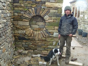 Adam with Tess and his niche - clever!